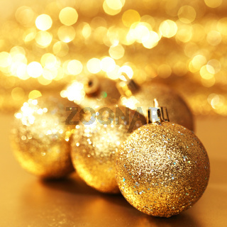 golden christmas ball on golden bokeh background
