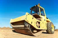 Compactor at road compaction works