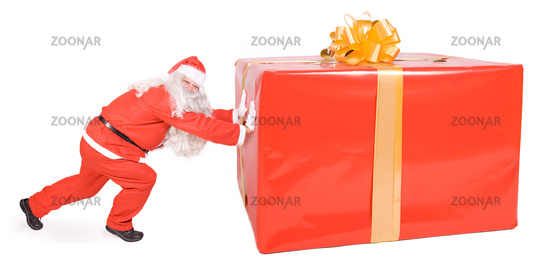 Santa Claus pushing at a big gift