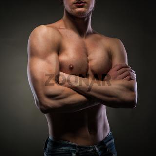 Muscular naked man on black