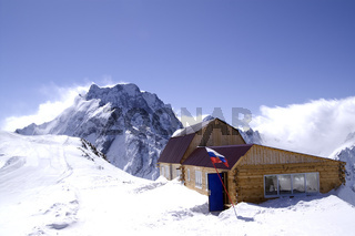 Wooden houses in high mountains. Ski resort