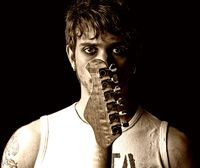 Young man with guitar portrait grunge punk rock