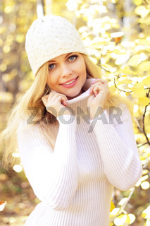 Portrait of a beautiful girl on a background of autumn