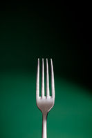 Fork over green background - Cooking concept