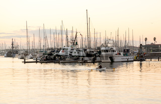 Rowing boat entering Ventura harbor dawn