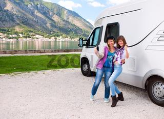 Happy womans outside motorhome