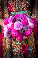 Indian brides hands holding bouquet
