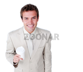 Smiling businessman holding a drinking cup against a white background