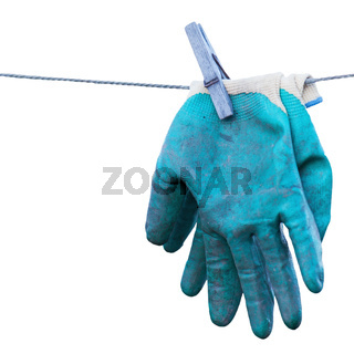 Old gardening gloves isolated on white background.