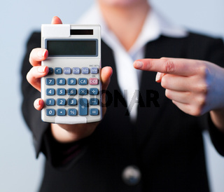 Business woman with a calculator