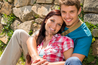 Young couple in love leaning against wall