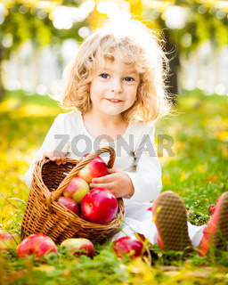 Child with basket of apples