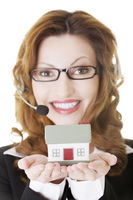 Call center assistant woman with house model