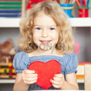 Child holding heart