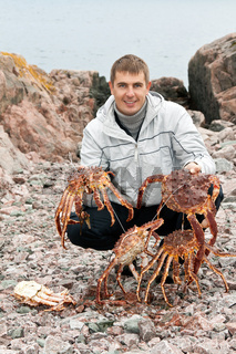 man with crabs in the Barents Sea coast