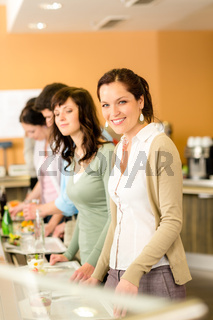 Business woman take cafeteria lunch smiling