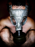 Nude man with gas mask in a black background