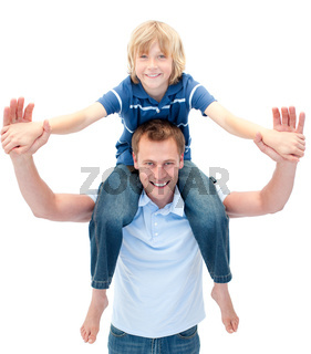 Charming father giving his son piggyback ride against a white background