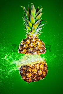Pineapple splashed with water