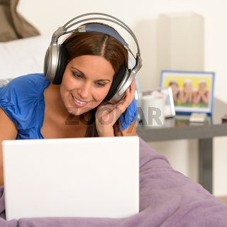 Teenage girl surfing on internet with laptop