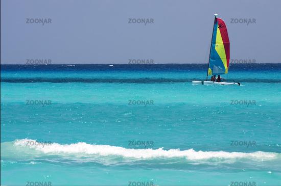 catamaran  boat  and coastline in mexico playa del carmen