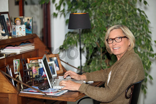 Older woman using a laptop