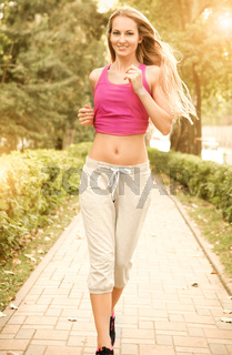 Sport fitness running young woman jogging