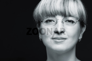 Portrait of the woman in eyeglasses close up