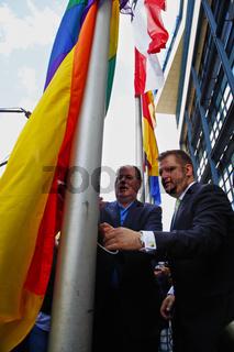Peer Steinbrueck hoists Rainbow Flag