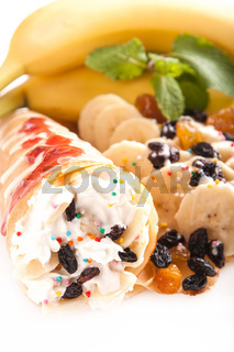 Rolled pancakes with sweet cream and fruits