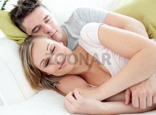 Relaxed lovers having fun together on a sofa