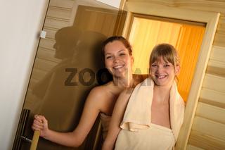 Happy women leaving sauna at wellness center