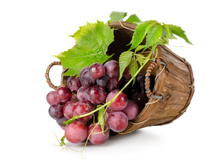Dark blue grapes in a wooden basket