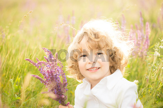 Happy child holding bouquet