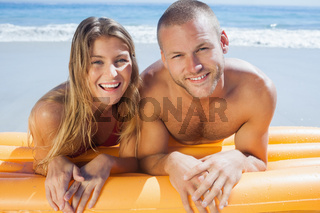 Happy cute couple in swimsuit posing