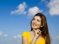 Happy woman thinking