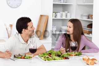 Young couple talking during their lunch