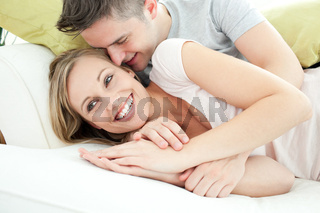 Adorable lovers having fun together in the living-room
