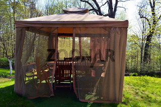 Arbor bower summerhouse with mosquito protect net