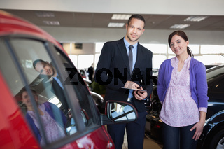 Woman and a salesman standing side by side