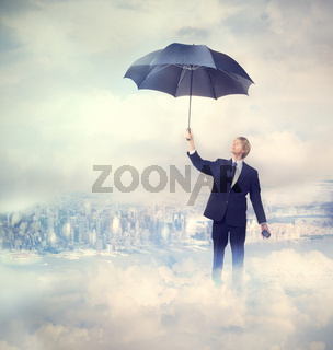 Business man holding an umbrella
