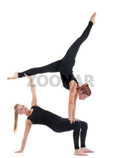 two young woman in black show acrobatic exercise