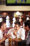 Men speak out for a beer at the bar