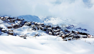 Winter mountain village landscape