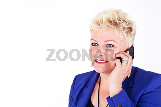 middelaged business woman in jacket talking on the phone