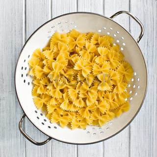 pasta farfalle in strainer