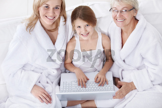 Three women of different ages with a laptop