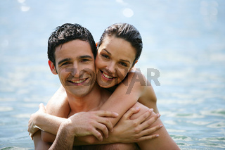 Couple hugging in the water