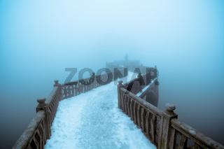 zigzag bridge in winter fog