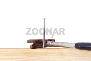 Hammer and nail with wooden board